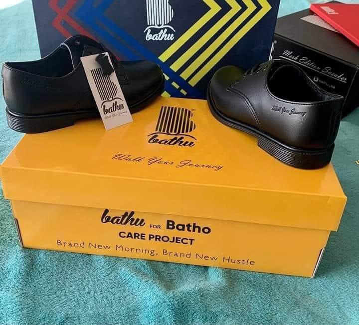 Bathu giving shoes